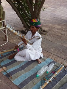 Musician playing the ravanhatta at Jodhpur's Mehrangarh Fort. (Sarah Lin Bhatia)